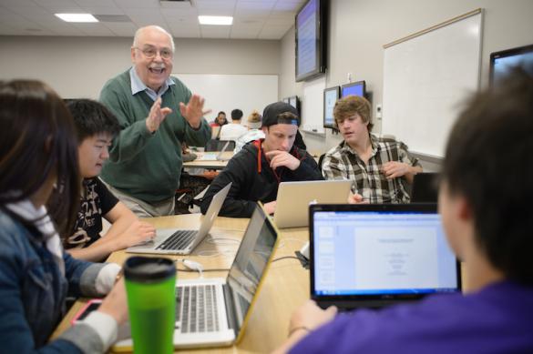 Professor helping students